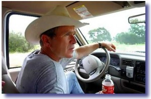 George Bush in his pick-up truck on his ranch in Crawford, TX.