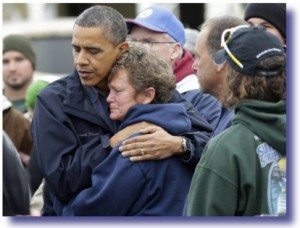 President Obama Comforts Woman